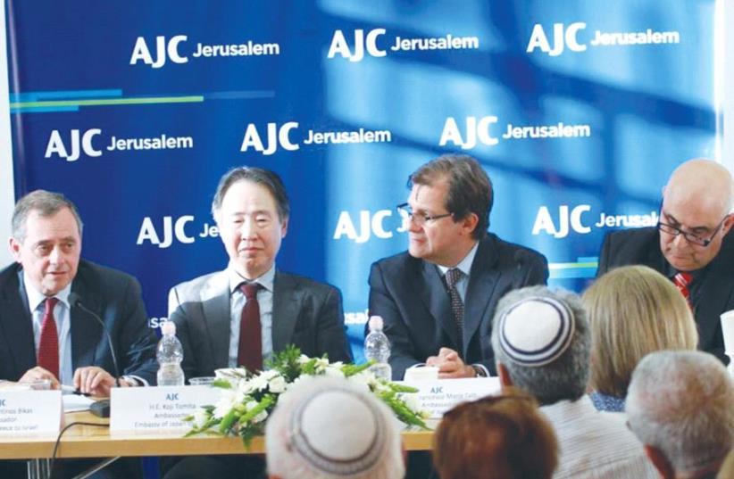 PARTICIPATING IN A panel discussion in Jerusalem on Thursday are, from left, Greek Ambassador Konstantinos Bikas, Japanese Ambassador Koji Tomita, Italian Ambassador Francesco Maria Talo and the IBA's Elihu Ben-Onn (photo credit: AJC)