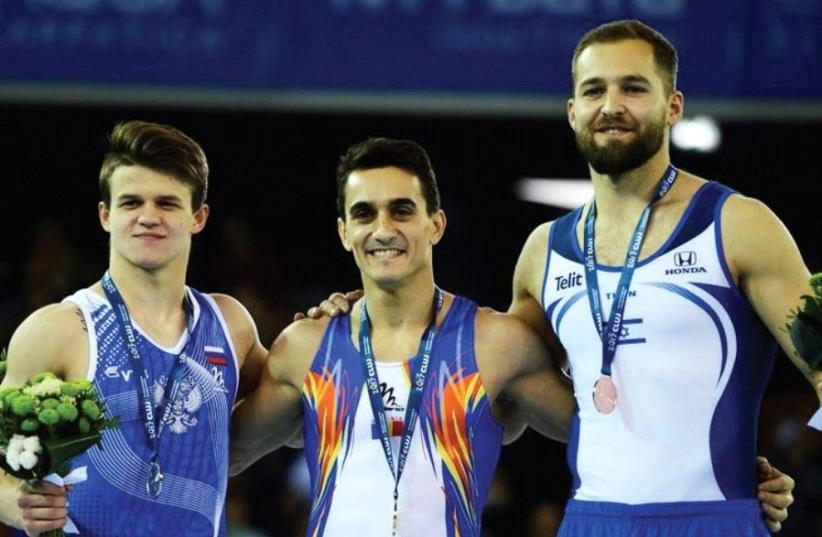 Israel's Alex Shatilov (right) won the bronze medal in the floor final at the European Artistic Gymnastics Championships Romania yesterday, finishing behind Romanian winner Marian Dragulescu (center) and Russia's Dmitri Lankin (left). (photo credit: EUROPEAN ARTISTIC GYMNASTICS CHAMPIONSHIPS WEBSITE)
