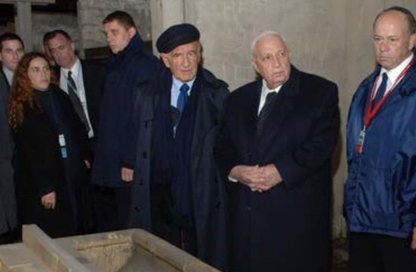 Shmuel Rosenman (right) visits an Auschwitz barrack with Ariel Sharon and Elie Wiesel (photo credit: MOTL)