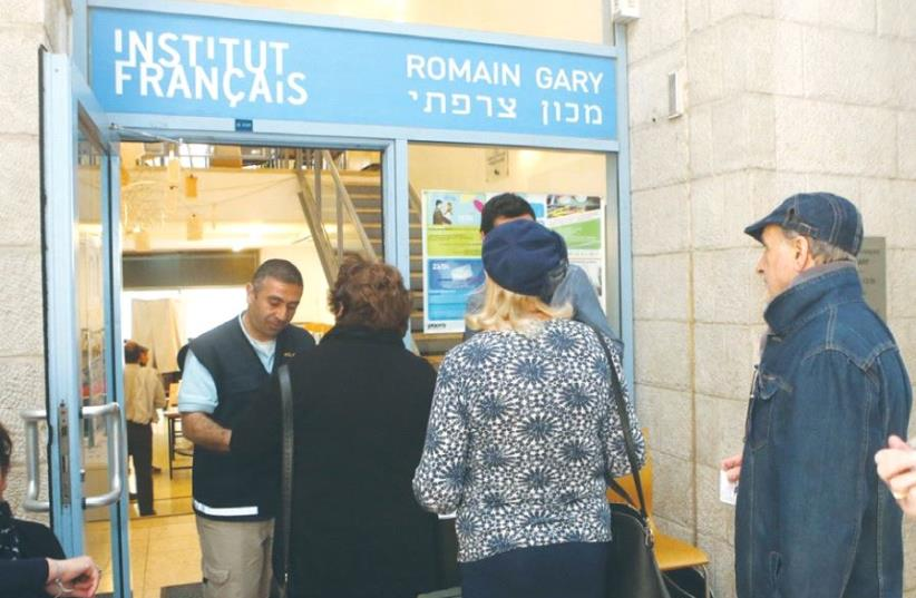 VOTERS STAND in line at the French Institute in Tel Aviv yesterday. (photo credit: MARC ISRAEL SELLEM)