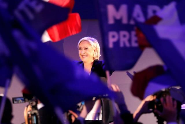 Marine Le Pen, French National Front (FN) political party leader and candidate for French 2017 presidential election, celebrates after early results in the first round of 2017 French presidential election, in Henin-Beaumont, France (photo credit: REUTERS)