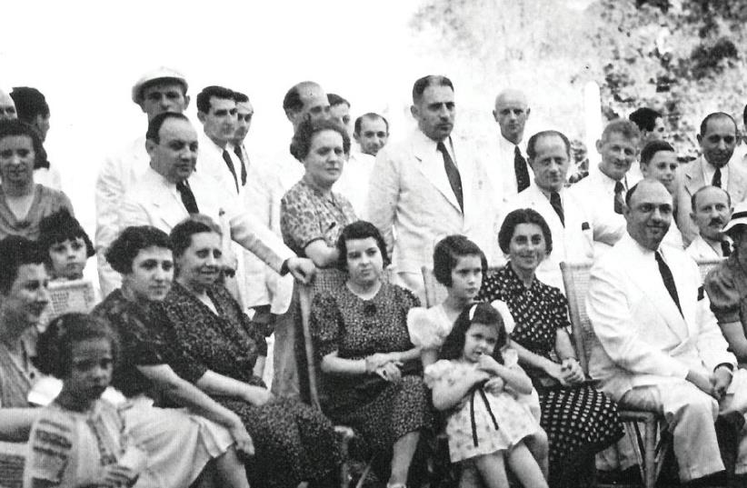 Cigar maker and rescuer Alex Frieder (seated at center middle), brother of Herbert, sits among Jewish refugees (photo credit: 3 ROADS COMMUNICATIONS)