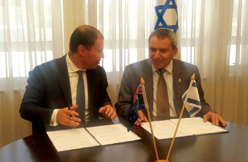 ENVIRONMENTAL PROTECTION MINISTER Ze'ev Elkin (right) and his Australian counterpart, Josh Frydenberg, sign a declaration of intent for cooperation on environmental issues yesterday at the ministry (photo credit: MINISTRY OF ENVIRONMENTAL PROTECTION)