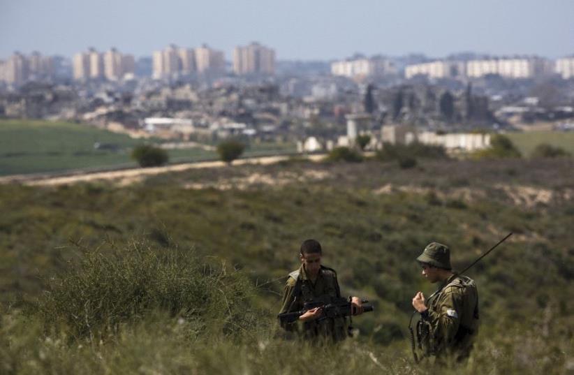 IDF soldiers near Gaza border (photo credit: REUTERS)