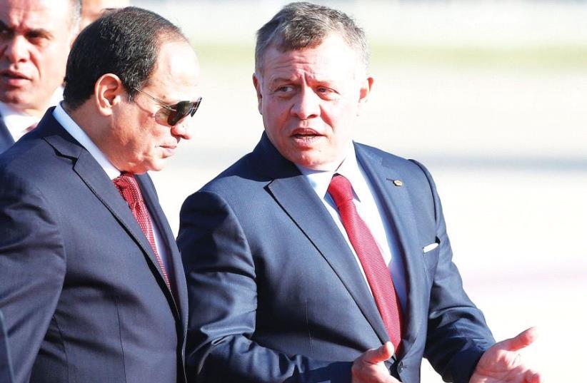 JORDAN'S KING Abdullah II welcomes Egypt's President Abdel Fattah al-Sisi during a reception ceremony (photo credit: REUTERS)