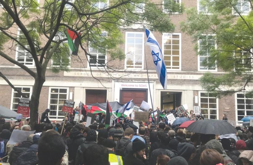 Protesters and counter-protesters gather outside London's School of Oriental and African Studies (photo credit: JOSH DELL)