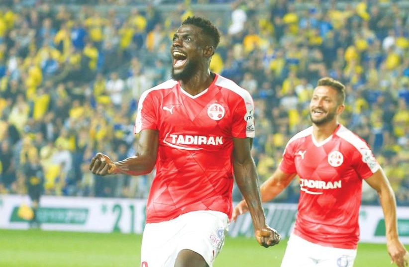 Hapoel Beersheba midfielder John Ogu celebrates after scoring the winner in last night's 2-1 victory over Maccabi Tel Aviv in Netanya (photo credit: DANNY MARON)