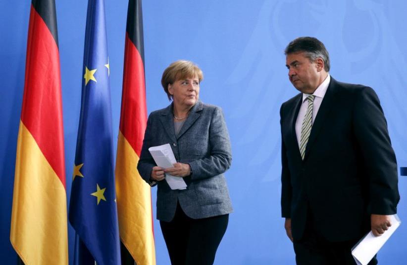 Angela Merkel and Sigmar Gabriel. (photo credit: REUTERS)