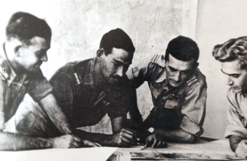 Harold 'Smoky' Simon (second left, inset) goes over plans with then-Israel Air Force commander Aharon Remez (left) and two unidentified serviceman during the War of Independence. (photo credit: Courtesy)