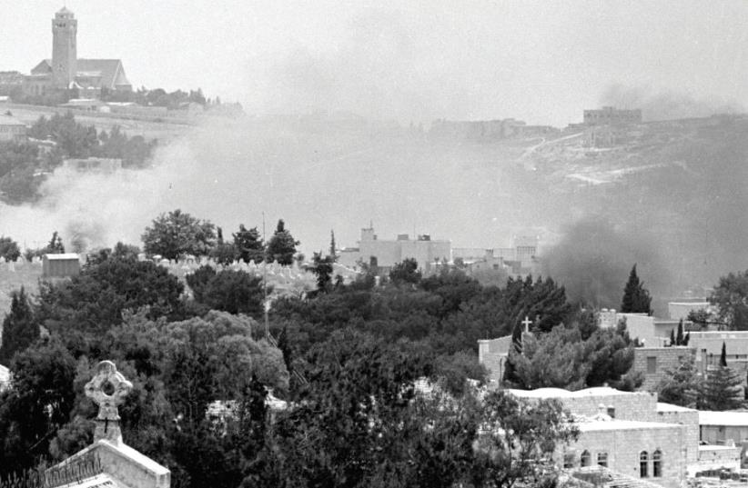 Smoke rises in east Jerusalem during a battle in the Six Day War (photo credit: REUTERS)