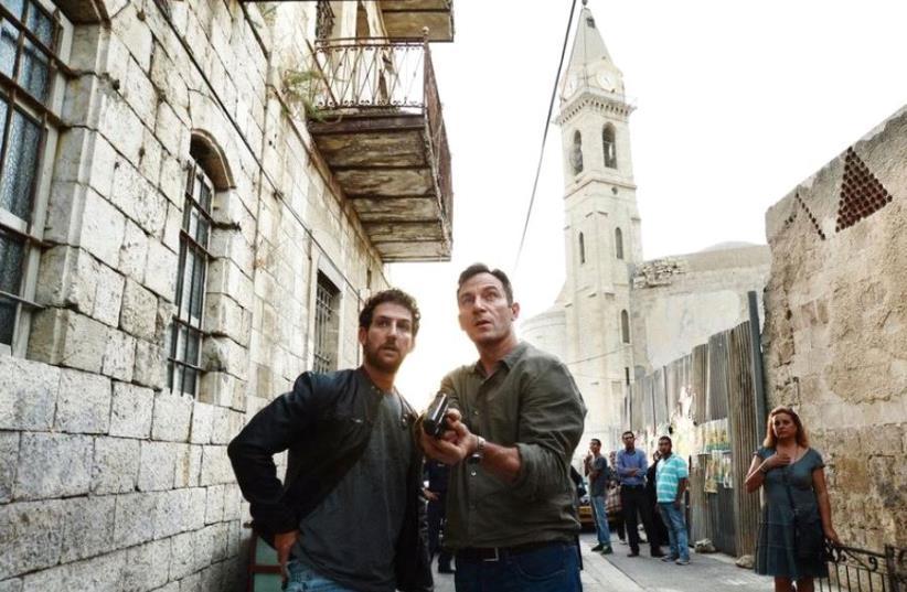 JASON ISAACS (right) and Ori Pfeffer on the set of 'Dig.'  (photo credit: RONEN AKERMAN/USA NETWORK)