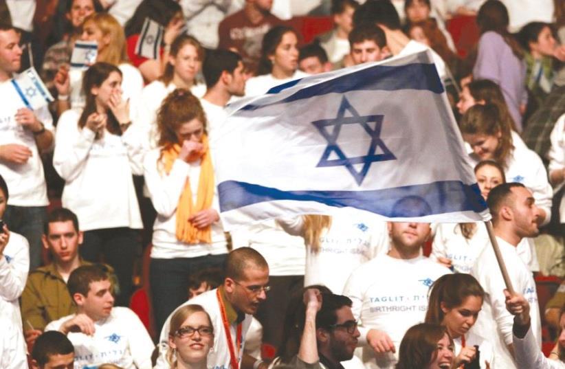 YOUTH ATTEND a Birthright-Israel event in Jerusalem. (photo credit: MARC ISRAEL SELLEM/THE JERUSALEM POST)