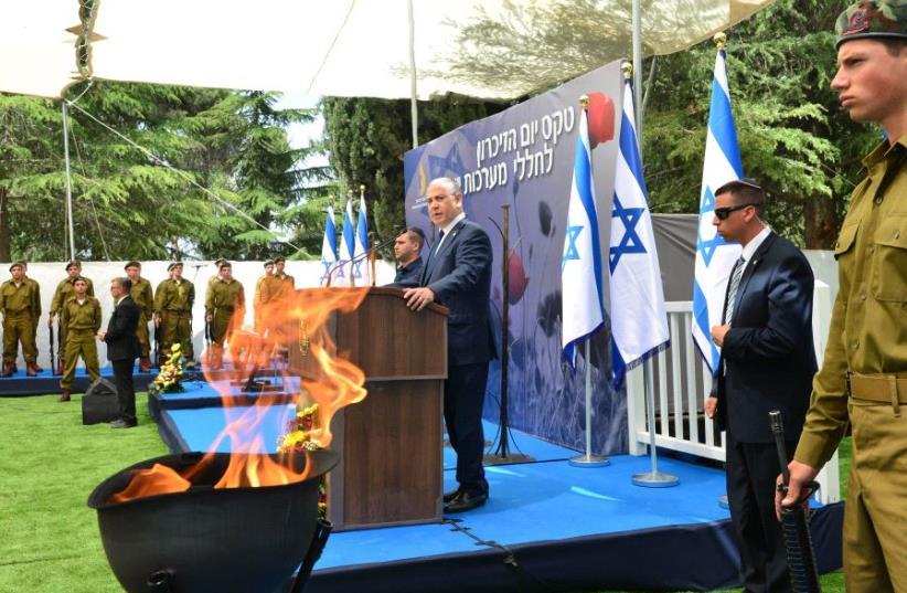 Prime Minister Benjamin Netanyahu at the official Memorial Day State Ceremony at Mt. Herzl Cemetery in Jerusalem (photo credit: KOBI GIDEON/GPO)