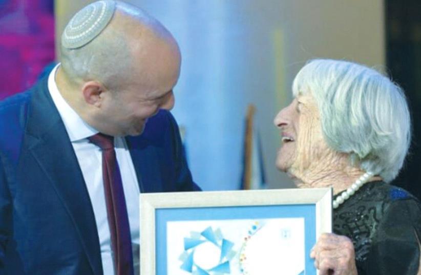 AGNES KELETI receives the Israel Prize from Education Minister Naftali Bennett in Jerusalem (photo credit: SHLOMI AMSALEM)