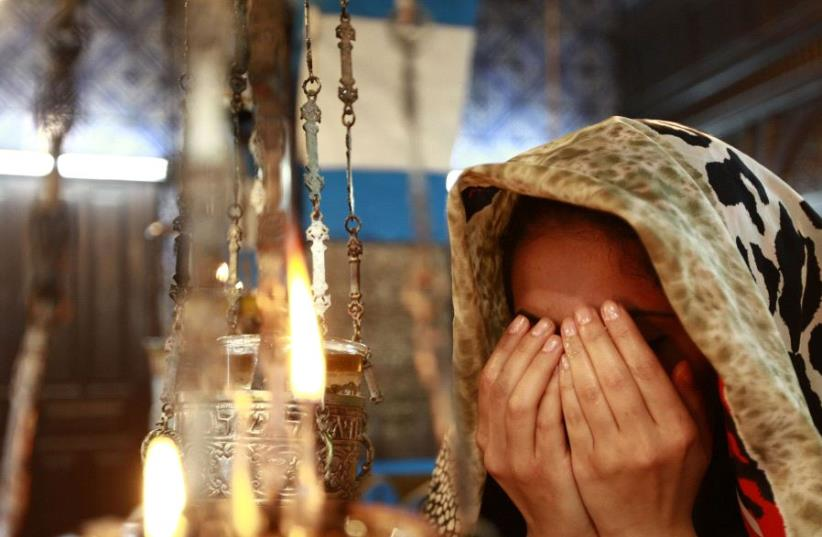 A Jewish worshipper prays during a pilgrimage to the El Ghriba synagogue in Djerba April 28, 2013 (photo credit: REUTERS)