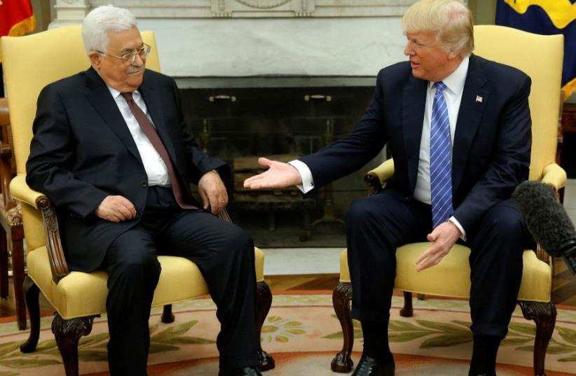 US President Donald Trump (R) welcomes Palestinian Authority President Mahmoud Abbas in the Oval Office at the White House in Washington on May 3, 2017 (photo credit: REUTERS)
