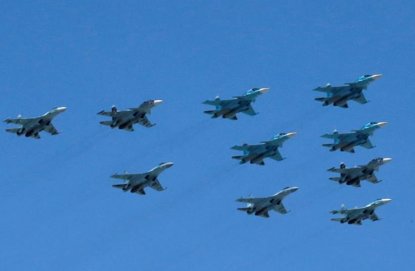 Russian Sukhoi Su military jets, including Su-35S Super-Flanker fighters. (photo credit: REUTERS/MAXIM SHEMETOV)