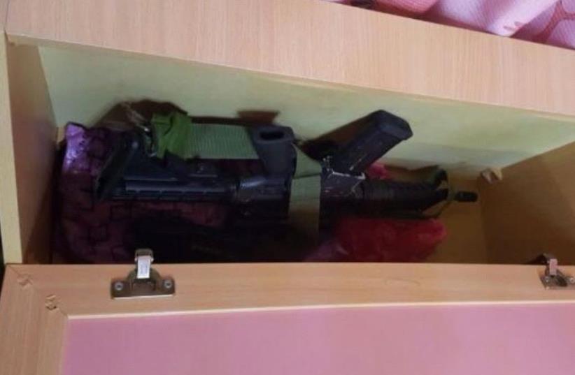IDF finds gun under childs bed in raid. (photo credit: IDF)