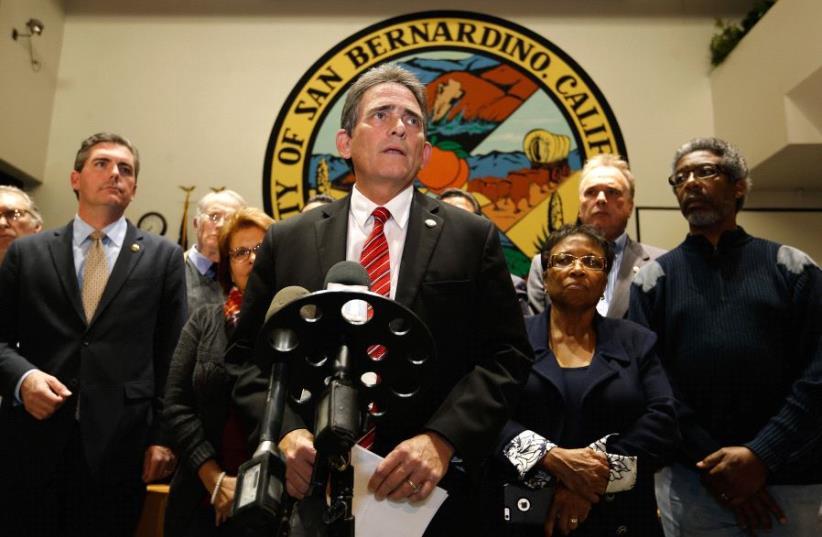 The Mayor of San Bernadino, Carey Davis, speaks during a press conference at City Hall regarding the shooting that took place inside the Inland Regional Center on December 2, 2015 in San Bernardino, California. (photo credit: SEAN M. HAFFEY / GETTY IMAGES NORTH AMERICA / AFP)