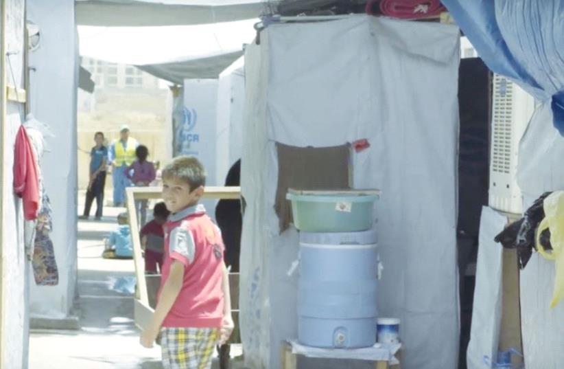 A CHILD at a refugee camp in Ankawa, Iraqi Kurdistan, is seen in a still from 'Faithkeepers.' (photo credit: Courtesy)