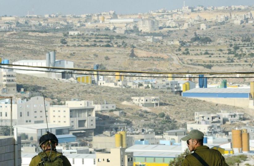 Soldiers overlook the Hebron region in 2014 (photo credit: KOBI GIDEON/GPO)
