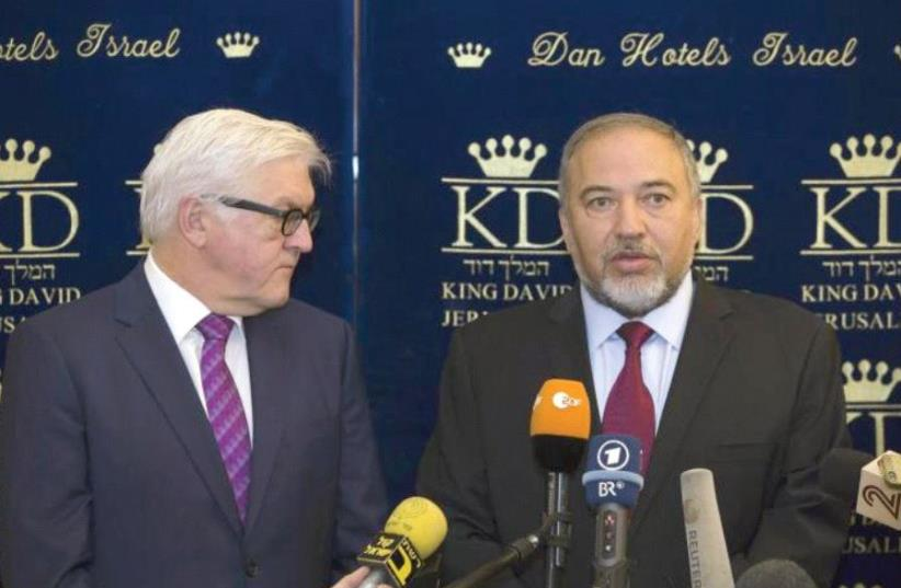 FOREIGN MINISTER Avigdor Lieberman meets his then-German counterpart Frank-Walter Steinmeier at the King David Hotel in 2014. (photo credit: REUTERS)
