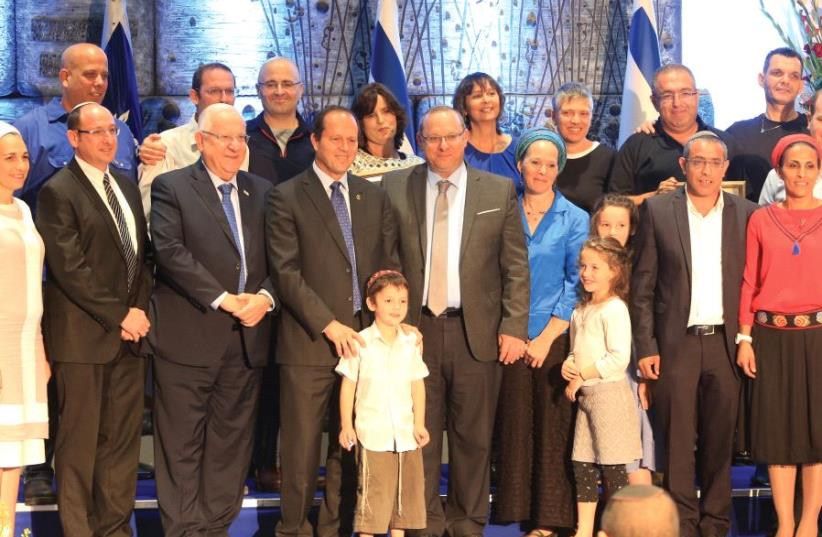 THE FRAENKEL, Shaer and Yifrach families, with President Reuven Rivlin and Jerusalem Mayor Nir Barkat at the Jerusalem Unity Prize award ceremony. (photo credit: SASSON TIRAM)