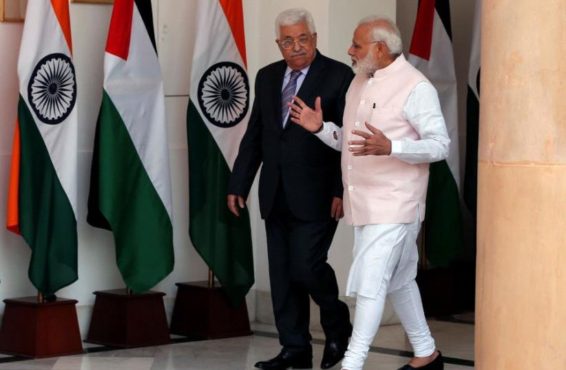 Palestinian Authority President Mahmoud Abbas (L) and India's Prime Minister Narendra Modi arrive for a photo opportunity, ahead of their meeting at Hyderabad House in New Delhi, India May 16, 2017 (photo credit: REUTERS)