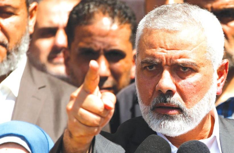 HAMAS LEADER Ismail Haniyeh gestures during a news conference in Gaza City earlier this month (photo credit: REUTERS)