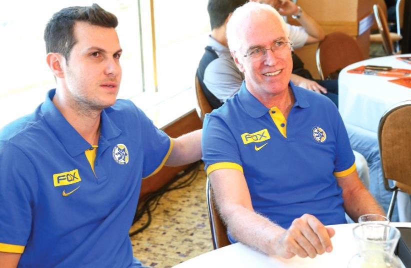 Maccabi Tel Aviv's new coach Arik Shivek (right) sits alongside captain Guy Pnini. (photo credit: DANNY MARON)
