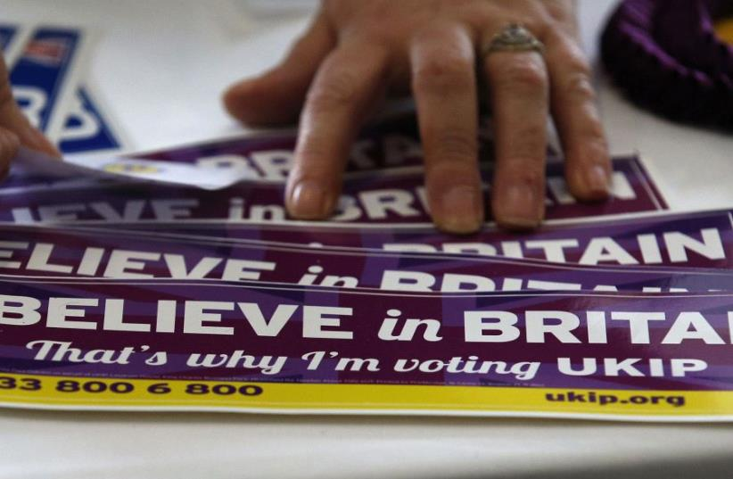 United Kingdom Independence Party (UKIP) stickers are displayed for sale at the party's spring conference in Bolton, Britain, February 17, 2017. (photo credit: REUTERS)