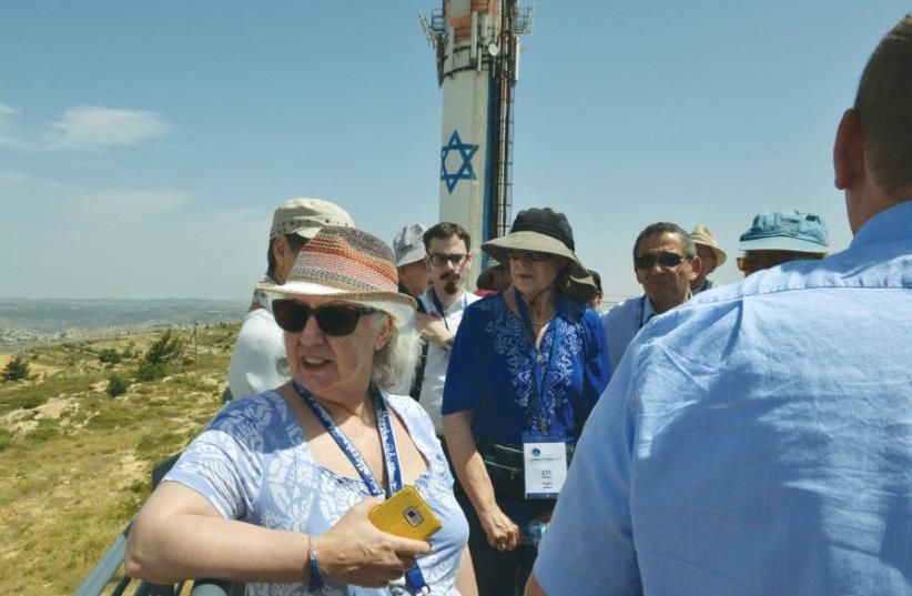 THE GROUP takes in the view from Neveh Daniel, a settlement in western Gush Etzion, on Thursday. (photo credit: YEHUDIT HOFMAN)