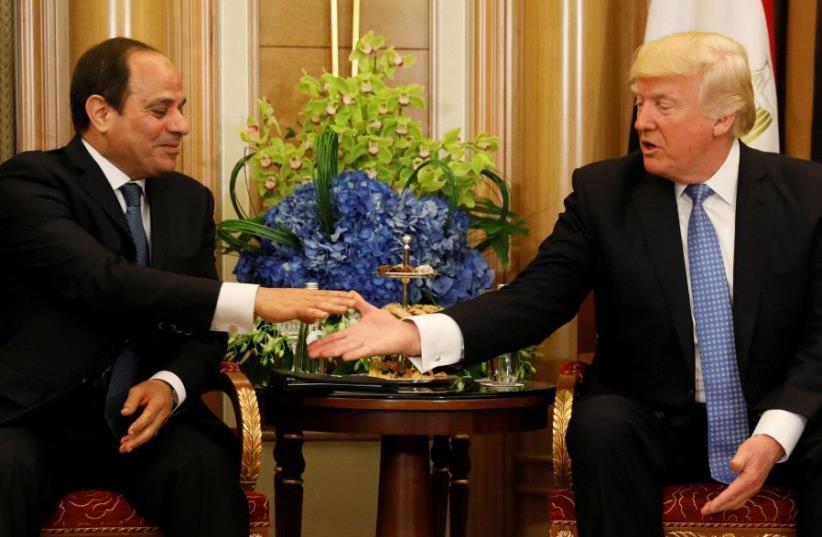 US President Donald Trump (R) meets with Egypts President Abdel Fattah al-Sisi in Riyadh, Saudi Arabia May 21, 2017. (photo credit: REUTERS / JONATHAN ERNST)