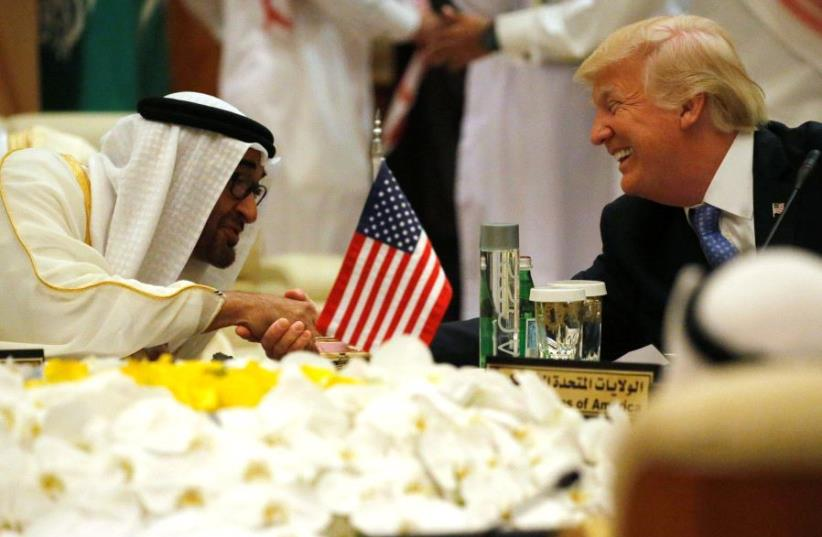 US President Donald Trump shakes hands with Abu Dhabi Crown Prince and Deputy Supreme Commander of the United Arab Emirates Armed Forces Mohammed bin Zayed al-Nahayan as he sits down to a meeting with of Gulf Cooperation Council leaders during their summit in Riyadh, Saudi Arabia (photo credit: JONATHAN ERNST / REUTERS)