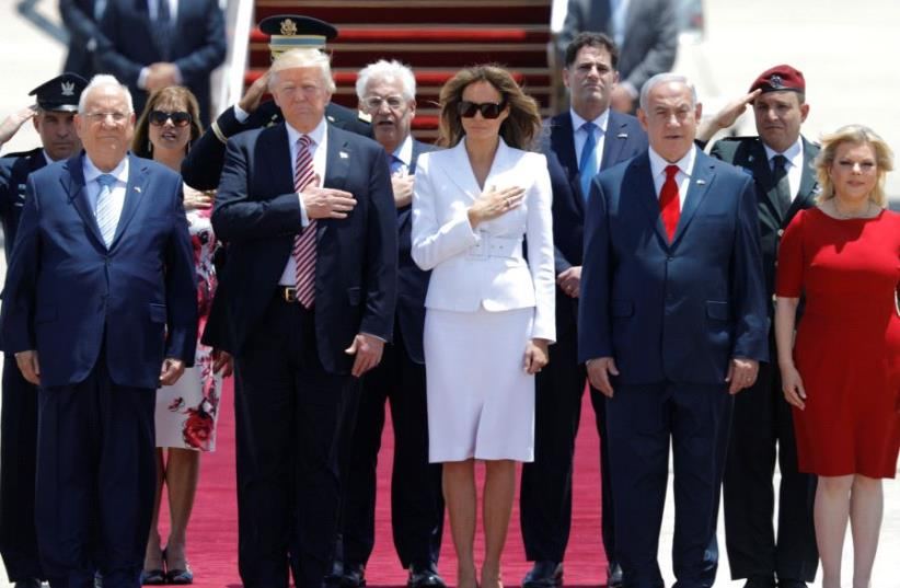 US President Donald Trump (2nd L) and first lady Melania Trump (3rd L) walk with Israeli Prime Minister Benjamin Netanyahu (2nd R), his wife Sara (R) and David Friedman (Center back), the new United States Ambassador to Israel, upon their arrival at Ben Gurion International Airport in Lod near Tel A (photo credit: REUTERS)