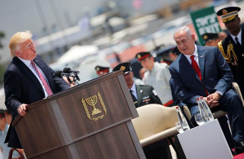 Prime Minister Benjamin Netanyahu (R) listens as U.S. President Donald Trump (L) speaks during a welcoming ceremony upon his arrival at Ben Gurion International Airport in Lod near Tel Aviv, Israel May 22, 2017 (photo credit: REUTERS)