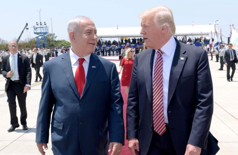 US President Donald Trump and PM Netanyahu at Ben Gurion airport (photo credit: AVI OHAYON - GPO)