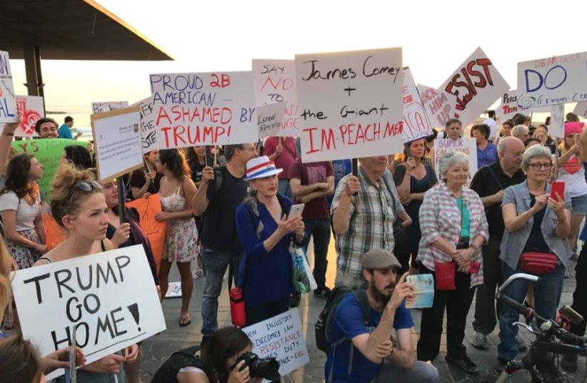 PROTESTERS DEMONSTRATE against US President Donald Trump in Tel Aviv yesterday. (photo credit: ELIYAHU KAMISHER)