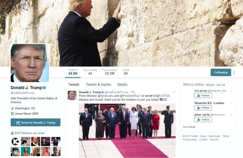 A still image of Donald Trump's Twitter account with a photograph of him at the Western Wall as the banner image (photo credit: screenshot)