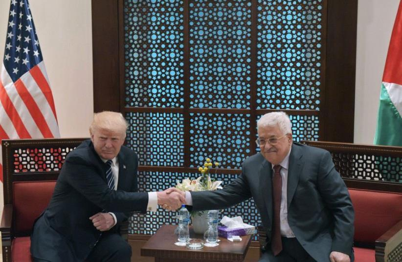 US President Donald Trump takes part in a bilateral meeting with Palestinian Authority President Mahmud Abbas at the Presidential Palace in Bethlehem on May 23, 2017 (photo credit: MANDEL NGAN / AFP)