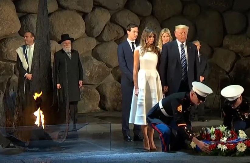 Donald Trump, Melania Trump, Ivanka Trump, and Jared Kushner place a wreath at Israel's Yad Vashem holocaust memorial.  (photo credit: screenshot)