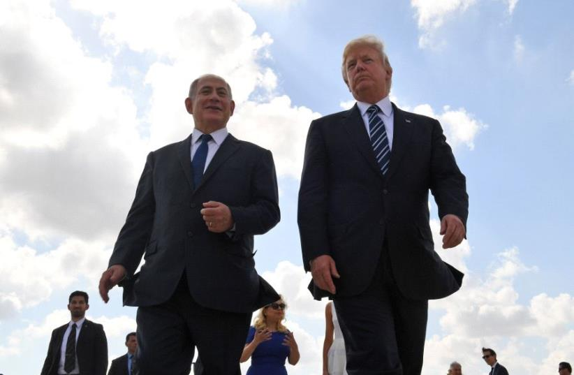 Prime Minister Benjamin Netanyahu and US President Donald Trump at Ben Gurion International Airport (photo credit: KOBI GIDEON/GPO)