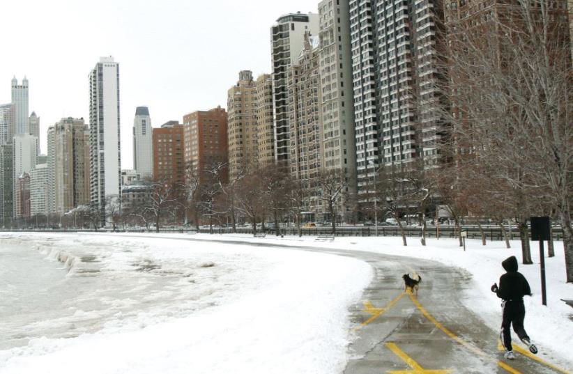 A man runs along Lake Michigan in Chicago in 2010 (photo credit: REUTERS)