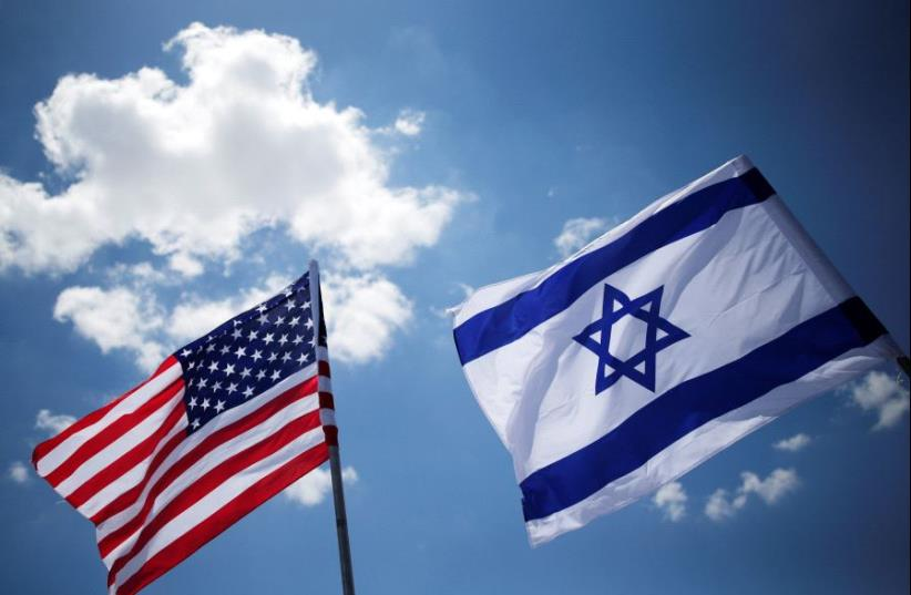 American and Israeli flags (photo credit: REUTERS)