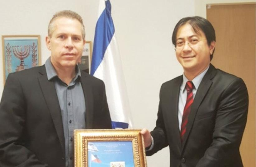 PUBLIC SECURITY Minister Gilad Erdan with Philippines Ambassador Neal Imperial. (photo credit: Courtesy)