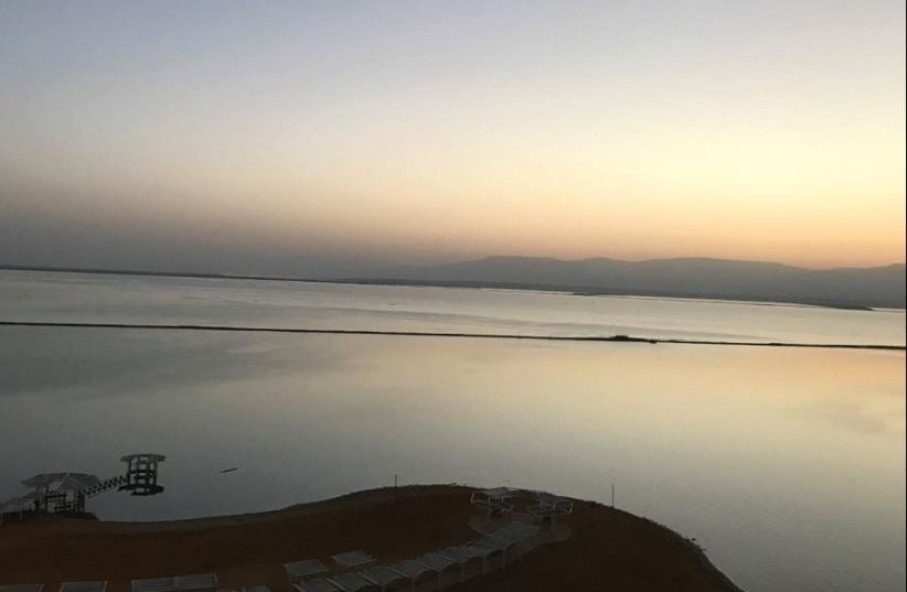 A view of the Dead Sea and Ein Bokek promenade at sunrise (photo credit: SETH J. FRANTZMAN)