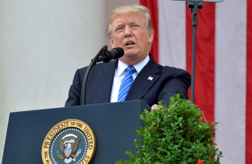 U.S. President Donald Trump makes remarks at the Amphitheater after laying a wreath at the Tomb of the Unknown Soldier at Arlington National Cemetery as part of Memorial Day observance, Arlington, Virginia, U.S., May 29, 2017 (photo credit: REUTERS)