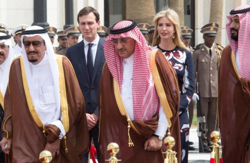 Saudi Arabia's King Salman bin Abdulaziz Al Saud (L), Saudi Crown Prince Muhammad bin Nayef , and White House senior adviser Jared Kushner and his wife Ivanka Trump walk during a reception ceremony at the Royal Court in Riyadh, Saudi Arabia May 20, 2017 (photo credit: REUTERS)