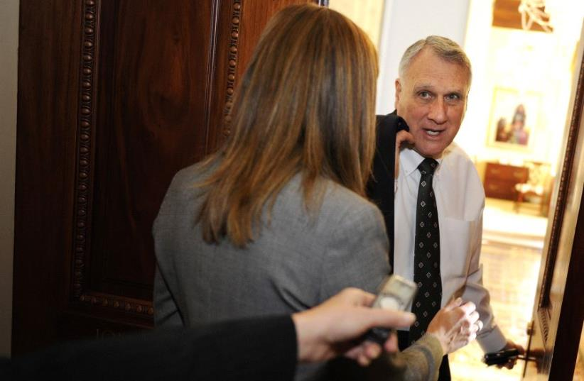 Senate Minority Whip Jon Kyl (R-AZ) talks to reporters as he walks to his office after meeting with Minority Leader Mitch McConnell (not pictured) at the U.S. Capitol in Washington, December 21, 2010 (photo credit: JONATHAN ERNST / REUTERS)