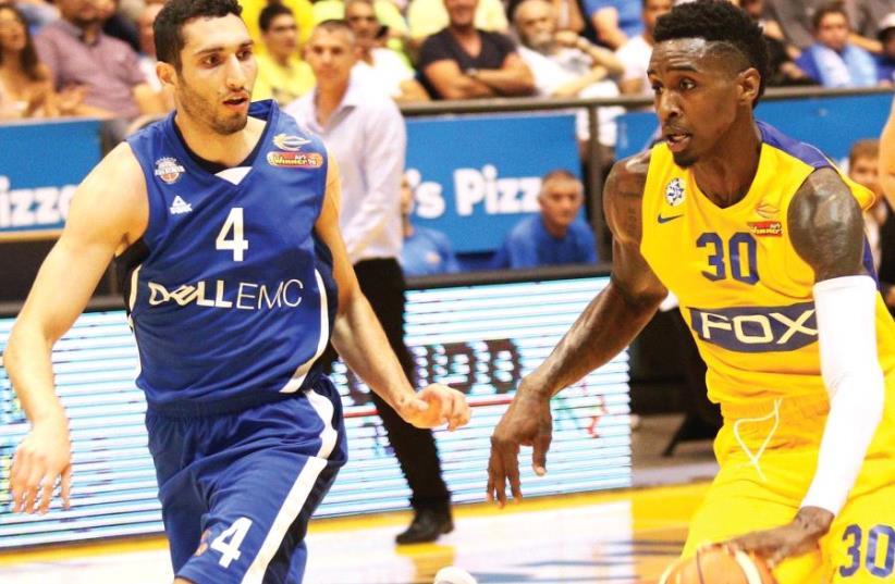 Maccabi Tel Aviv forward Quincy Miller (right) scored a game-high 19 points in last night's series-clinching 105-68 home win over Karam Mashour (left) and Bnei Herzliya. (photo credit: ADI AVISHAI)